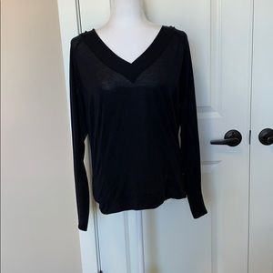 Lucy long black sleeve shirt with a hood.